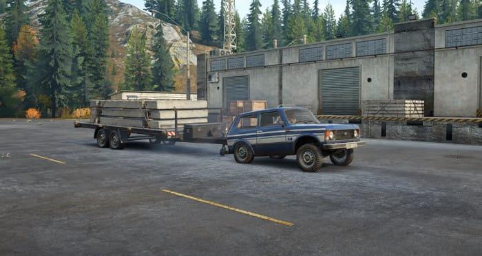 Нива в Игре СноуРаннер с прицепом и грузом бетонных плит