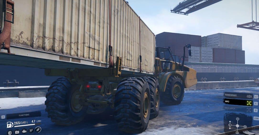 CAT 745C фото в SnowRunner с контейнером