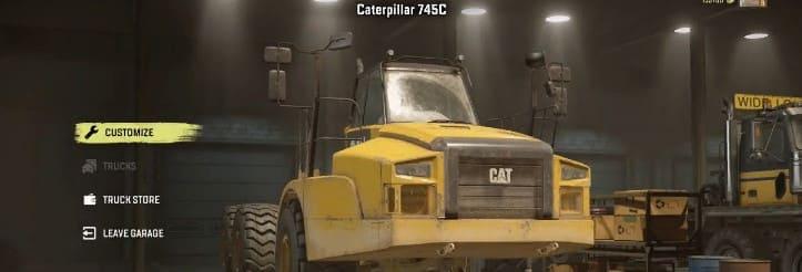 Caterpillar 745C в гараже
